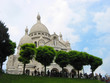 view of sacre coeur with trees