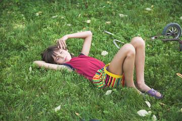boy rests by summer