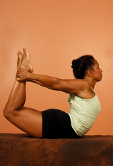 yoga pose spinal bend holding legs