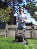 man mowing yard poster