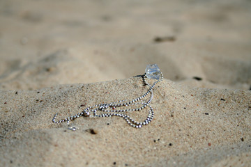 necklace in the sand