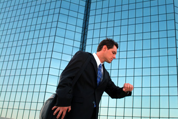 businessman checking watch