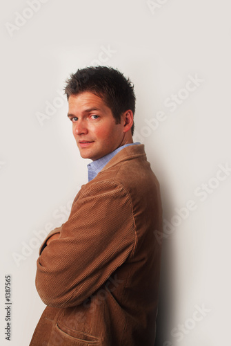 man with brown jacket