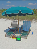 umbrella and lounge chairs poster