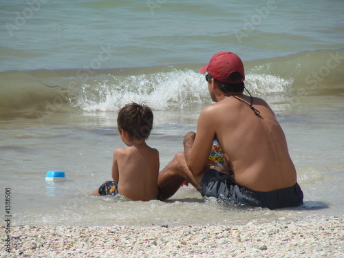 father and son at the beach 2