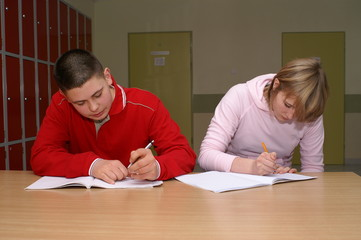 two students doing homework during the break