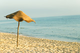 sun umbrella on the beach poster