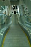 escalators at airport poster