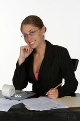 smiling young business woman with calculator