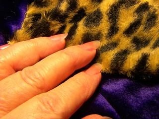 fingers on fur coat