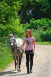 girl walk pony poster