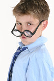 child looking over top of round glasses poster