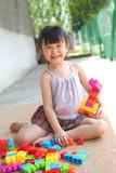 girl playing blocks