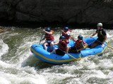 group of friends white water rafting in colorado.