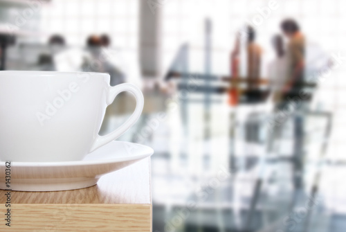 coffee cup on table in front of office - 1430362