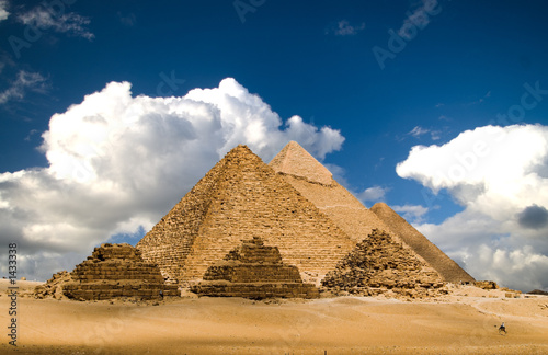 Leinwandbild Motiv pyramids and clouds