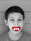 boy with wax fangs poster