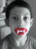 boy with wax teeth poster