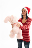 young beauty girl in sweater  and santa wear with pink rabbi poster