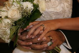bride and groom hands with rings, bands and flower poster