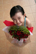girl holding bouquet of red roses