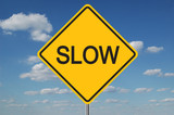 slow traffic sign with clouds poster