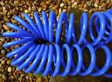 blue coiled plastic hosepipe poster