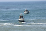 two coast guard boats in rescue operation poster