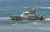 us coast guard boat at rescus operation poster