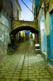 arabian street in medina during evening poster