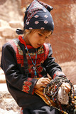 young asian girl selling beads poster