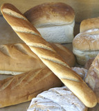 display of bread in shop window of bakery poster