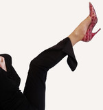 young woman kicking leg with high heel shoe poster