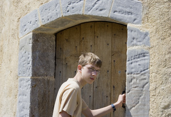 teen opens an old door
