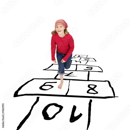 girl hopping around playing hopscotch