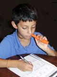 boy doing homework poster