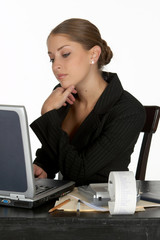 young business woman in thought at computer