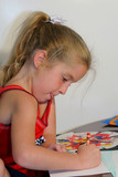 child coloring on paper - sticking out tongue poster