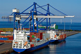 container ship and loading crane in port