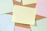 close up of post-it notes on corkboard poster