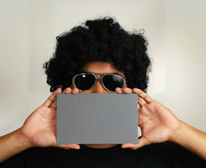 afro man holding blank card