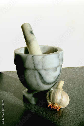 pestle and mortar with garlic
