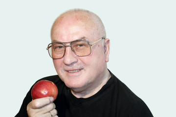 senior with an apple