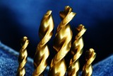 gold drill bits poster