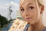 woman eating unleavened bread