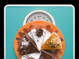 chocolate cake on weigh-scale poster