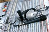 headphones on sound mixer poster