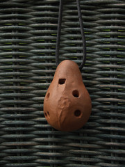 ocarina— eight-holed musical instrument