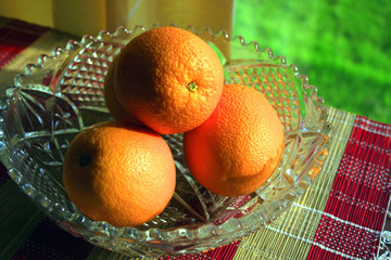 oranges in a glass fruit bowl