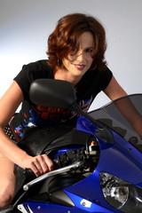 brunette girl on motorcycle